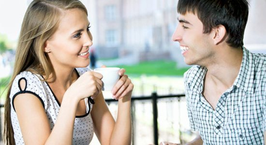 Beautiful young couple at cafe