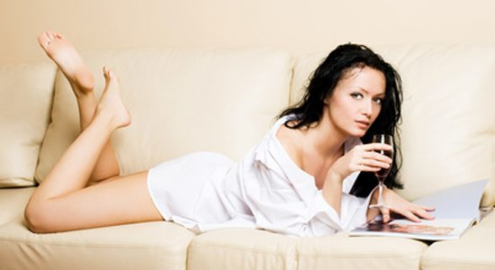 beautiful woman relaxing on the sofa with the magazine
