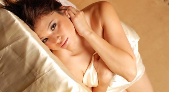 beautiful young naked female model on bed